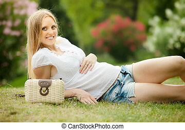 pregnant woman on grass