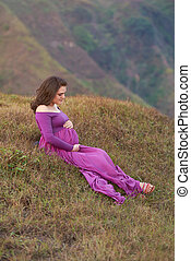 Pregnant woman on nature background