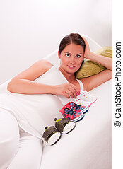 Pregnant woman on sofa at home