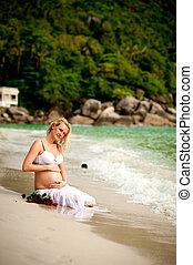 pregnant woman on the beach