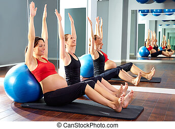 pregnant woman pilates exercise fitball