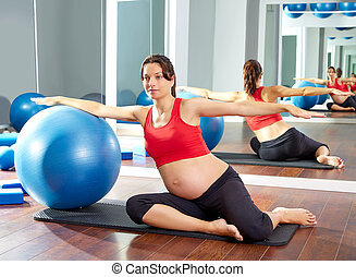 pregnant woman pilates mermaid fitball exercise