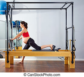 pregnant woman pilates reformer cadillac exercise