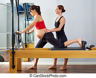 pregnant woman pilates reformer cadillac exercise workout ...