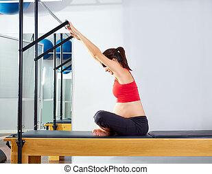 pregnant woman pilates reformer forward push through...