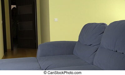 pregnant woman plaid sofa