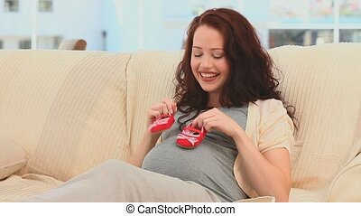 Pregnant woman playing with baby sh