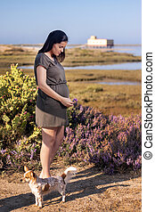 Pregnant woman poses on the marshlands.