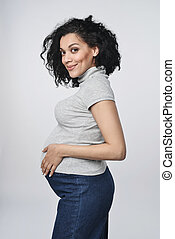 Pregnant woman profile - Pregnant woman holding touching her...