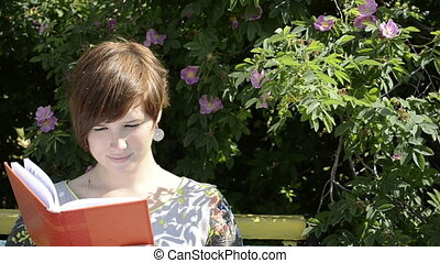 Pregnant woman reading notebook