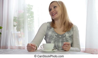 Woman relaxing with Cup of Tea