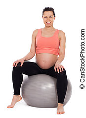Pregnant woman sitting on a ball