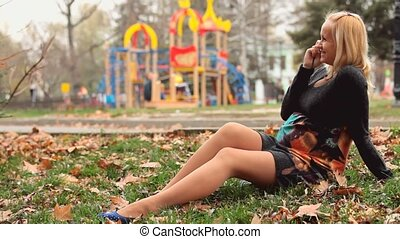 Pregnant Woman Sitting On The Grass