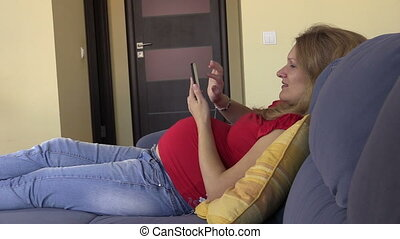 pregnant woman smartphone - Happy pregnant woman browse...