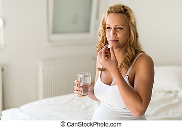 Pregnant woman taking medication