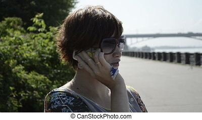 pregnant woman talking on her phone