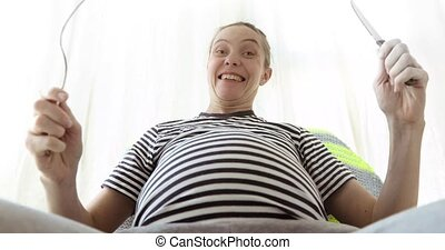 Pregnant woman thinking about food