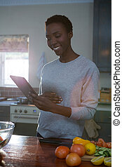 Pregnant woman using digital tablet