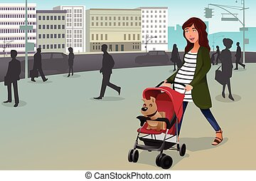 Pregnant woman walking with her dog and a stroller in the city