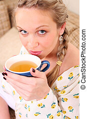 Pregnant woman with a cup of tea