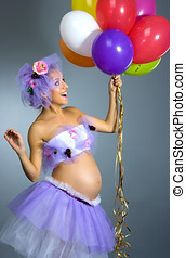 Pregnant woman with balloons - Young beautiful pregnant...