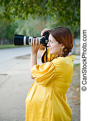 pregnant woman with camera