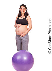 Pregnant woman with fitness ball