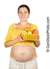 Pregnant woman with fruits