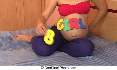 8 eighth pregnancy month - Pregnant woman with girl word on...