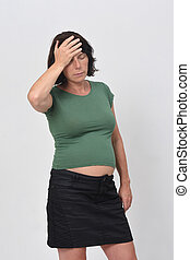 pregnant woman with headache on white background