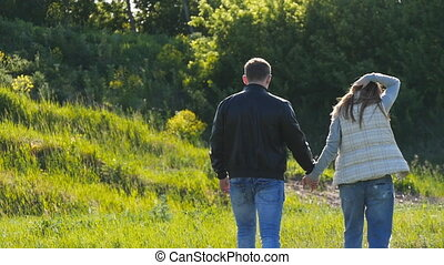 Pregnant woman with husband walking