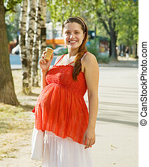 Pregnant woman with ice-cream