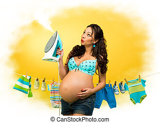 pregnant woman with iron on the background of children's...