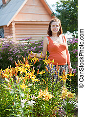 pregnant woman with lily plant