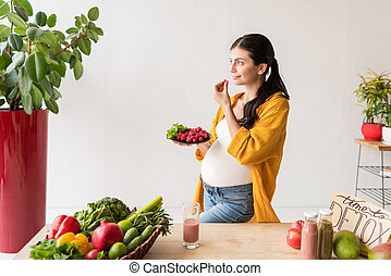 pregnant woman with organic food