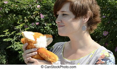 Pregnant woman with toy fox