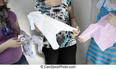 pregnant women, diapers and shirts