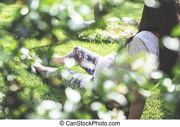 Pregnant women in the garden.