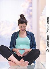 pregnant women sitting on the floor