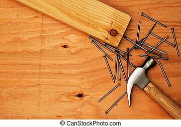 pregos, martelo, madeira compensada