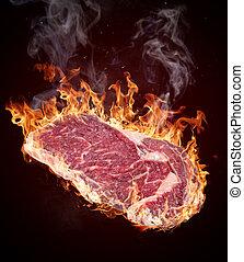 Premium Raw beef sirloin on black background