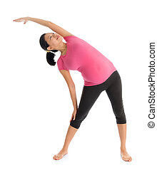 Prenatal yoga class. Full length healthy Asian pregnant ...