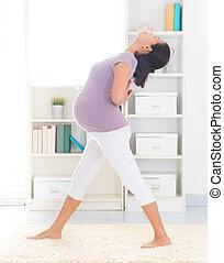 Prenatal yoga. Full length healthy 8 months pregnant calm ...