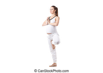 prenatal yoga vriksasana pose composite image of young