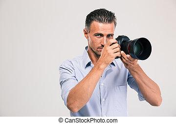 prendendo câmera, homem jovem, bonito