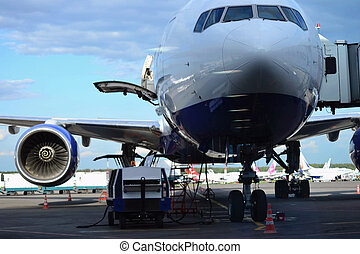 Preparation of aircraft before departure at the airport, Turbine of airplane under the wing, Boeing