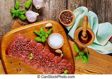 Preparation dish from raw beef and spices. Top viev.