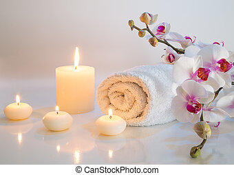 preparation for bath in white with towels, candles and...