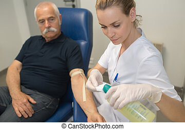 preparation for blood test with beautiful young blond doctor