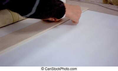 preparation for cutting wallpaper. Measurement and marking -...